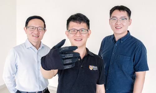 A team of NUS researchers with the InfinityGlove.